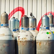 Free Gray Steel Gas Tanks Near White Steel Wall During Daytime Stock Photos - 93556243
