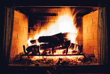 Free Fireplace With Burning Logs Royalty Free Stock Photography - 93556487