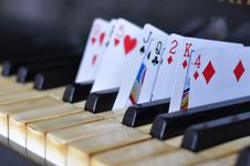 Free Playing Cards In Between Piano Keys Royalty Free Stock Image - 93556506