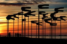 Free Silhouette Parasols Against Dramatic Sky During Sunset Stock Images - 93557254