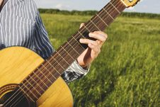 Free Man Playing Guitar On Field Royalty Free Stock Photography - 93557897