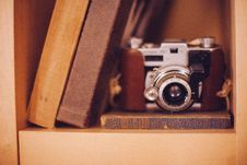 Free Old Film Camera In Bookshelf Royalty Free Stock Photos - 93557978