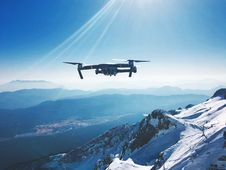 Free Drone Flying Over Snowy Mountains Stock Photography - 93558952