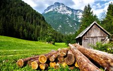 Free Lumber On Field At Mountain Cabin Stock Images - 93559214