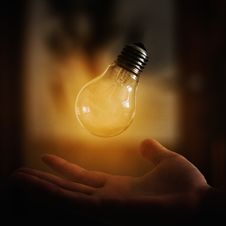 Free Light Bulb Above Hand Royalty Free Stock Image - 93560686