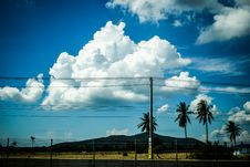 Free Clouds In Blue Skies Over Power Lines Royalty Free Stock Image - 93561656