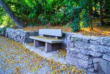 Free Park Bench On Stone Wall Stock Photo - 93561990