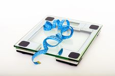 Free Blue Tape Measuring On Clear Glass Square Weighing Scale Stock Photography - 93563172