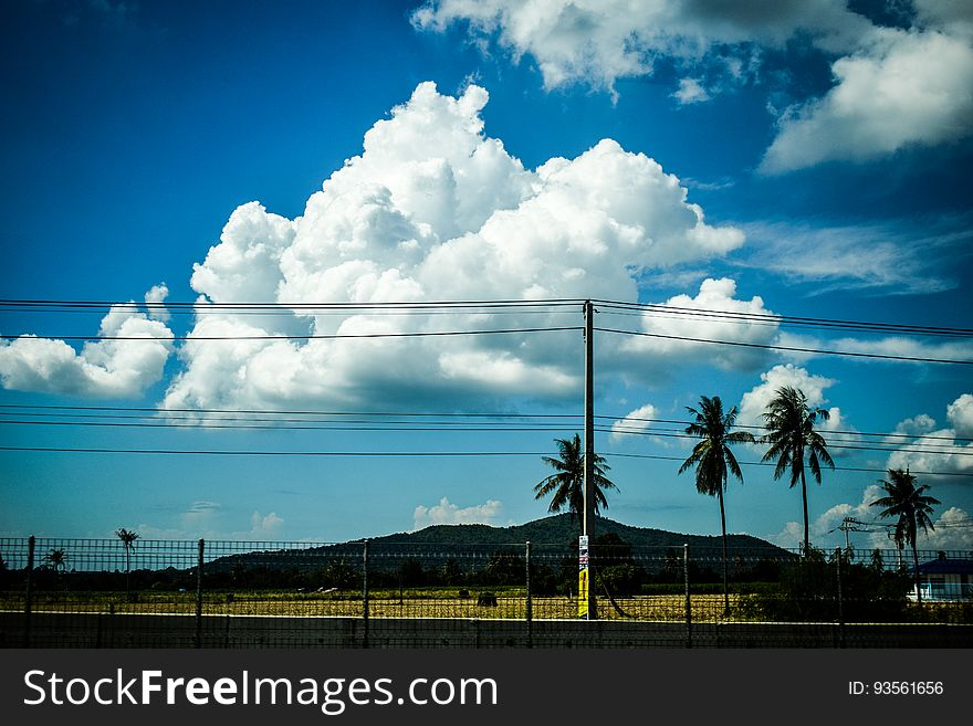 Clouds in blue skies over power lines