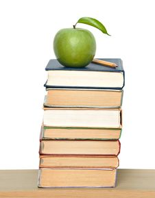 Free Green Ripe Apple And Pencil On Pile Of Books Royalty Free Stock Photography - 9360017
