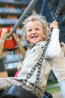 Little Boy Swinging. Stock Image