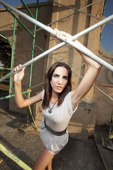 Free Woman Posing By Scaffolding Royalty Free Stock Images - 9366369