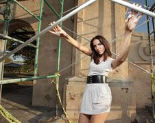 Free Woman Posing By Scaffolding Royalty Free Stock Images - 9366389