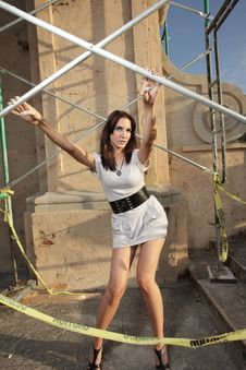 Free Woman Posing By Scaffolding Stock Image - 9366391