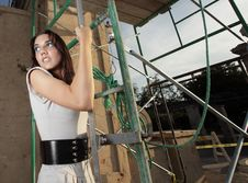 Free Woman Posing By Scaffolding Stock Image - 9366451