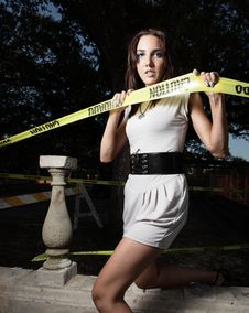 Woman Breaking Through The Caution Tape Stock Photos