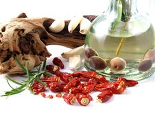 Oil, Garlic, And Chillies Stock Images