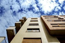 Free Apartment Building Against Blue Skies Royalty Free Stock Image - 93617676