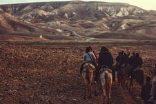 Free People Riding On Camel Near Mountain During Daytime Royalty Free Stock Photography - 93682397