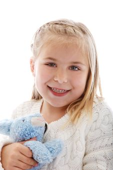 Cute Little Girl Wearing A White Sweater Stock Photo