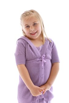 Cute Little Girl Wearing A Purple Sweater Stock Image