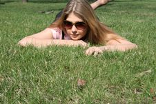 Free Girl Lying On Grass Royalty Free Stock Image - 9373546
