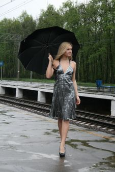 Free Girl Walking With An Umbrella Royalty Free Stock Image - 9373676