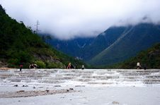 Free Yulong Snow Mountain-white River Or Tourists Stock Image - 9375541