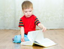 Free Boy Reads A Book Royalty Free Stock Images - 9379289