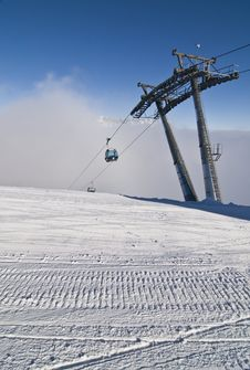 Free Groomed Snow And Ski Lift Stock Image - 9379771