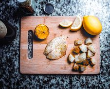 Free Fish And Potatoes On Cutting Board Stock Images - 93732164