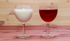 Glasses With Wine And Milk Stock Photos