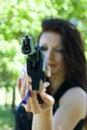 Free Woman Aiming Pneumatic Gun Royalty Free Stock Image - 9384606