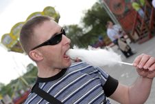 Free Man Eats Candy Floss Stock Image - 9380061