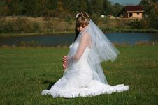 Free Beautiful Bride Sitting On A Meadow Royalty Free Stock Image - 9380686