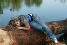 Free On The Fallen Tree Under Lake Stock Images - 9380954
