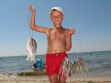 Free The Boy Sells  Fish Stock Photography - 9382622