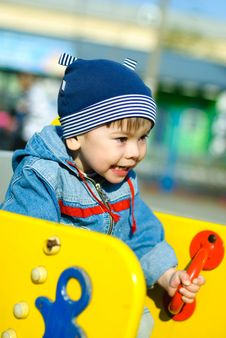 Cute Boy Playing Outddor Royalty Free Stock Photo