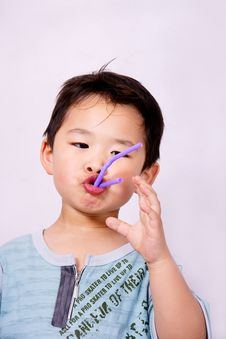 Free Boy Playing With Straw Stock Images - 9396384