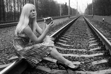 Girl With A Flask Sitting Near Railroad Stock Images