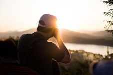 Free Man Photographing Sunset Stock Photography - 93999502
