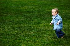 Free Toddler Running On Green Grass Stock Image - 942331