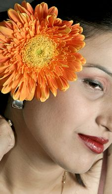 Smiling Girl With Gerbera Flower Stock Image