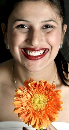 Smiling Girl With Gerbera Flower Royalty Free Stock Photos
