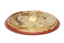 Russian Pancakes On The Red Plate (isolated) Royalty Free Stock Image