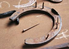 Free Horse Shoe And Nail Stock Photography - 9405102