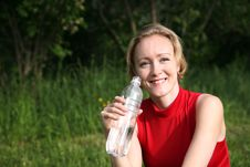 Woman With The Bottle Royalty Free Stock Image