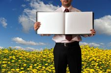 Free Man Showing A Book With Blank Pages Royalty Free Stock Photos - 9408028