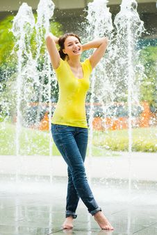 Free Young Caucasian Girl Playing At Fountain Royalty Free Stock Image - 9409116