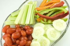 Colorful Cut Vegetables On Glass Plate Royalty Free Stock Photos